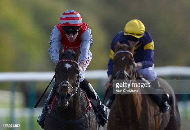 George Baker riding Top Offer win The Horse Racing Loyalty Bonus At winnercouk Handicap Stakes at Lingfield racecourse on October 21 2014 in...