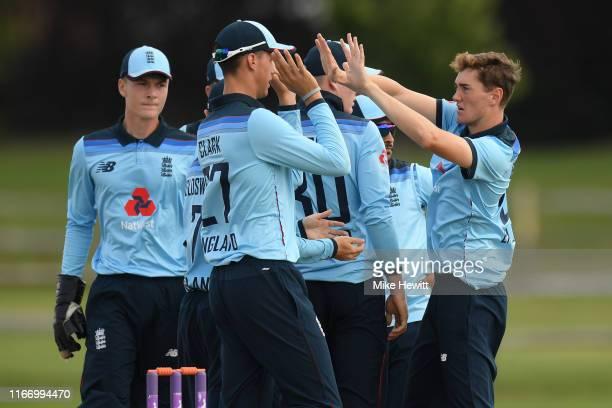 George Balderson of England U19 celebrates with team mates after dismissing Yashasvi Jaiswal of India U19 during an Under 19 TriSeries match between...