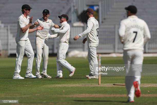 George Balderson of Lancashire celebrates after running out Durham's Gareth Harte with a direct hit during the The Bob Willis Trophy match between...