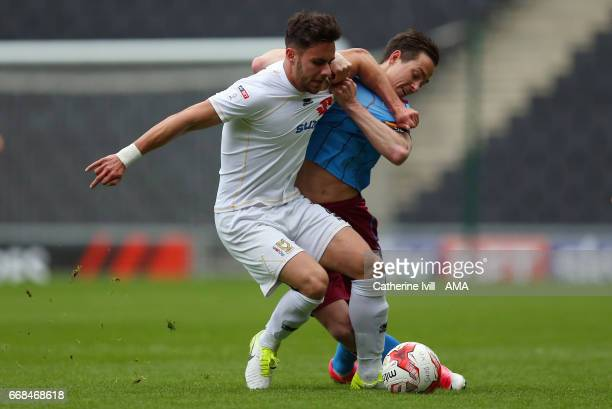 George Baldock of MK Dons and Josh Morris of Scunthorpe United during the Sky Bet League One match between MK Dons and Scunthorpe United at StadiumMK...