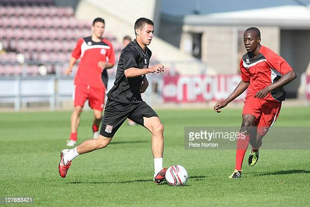 George Baldock of Northampton Town plays the ball watched by David Mayo during a training session at Sixfields Stadium on September 30 2011 in...