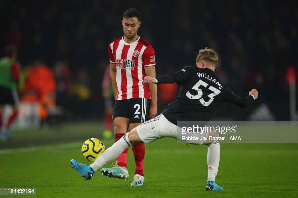 George Baldock of Sheffield United and Brandon Williams of Manchester United during the Premier League match between Sheffield United and Manchester...