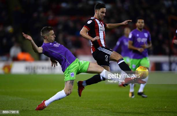 George Baldock of Sheffield United and Joe Bryan of Bristol City in action during the Sky Bet Championship match between Sheffield United and Bristol...