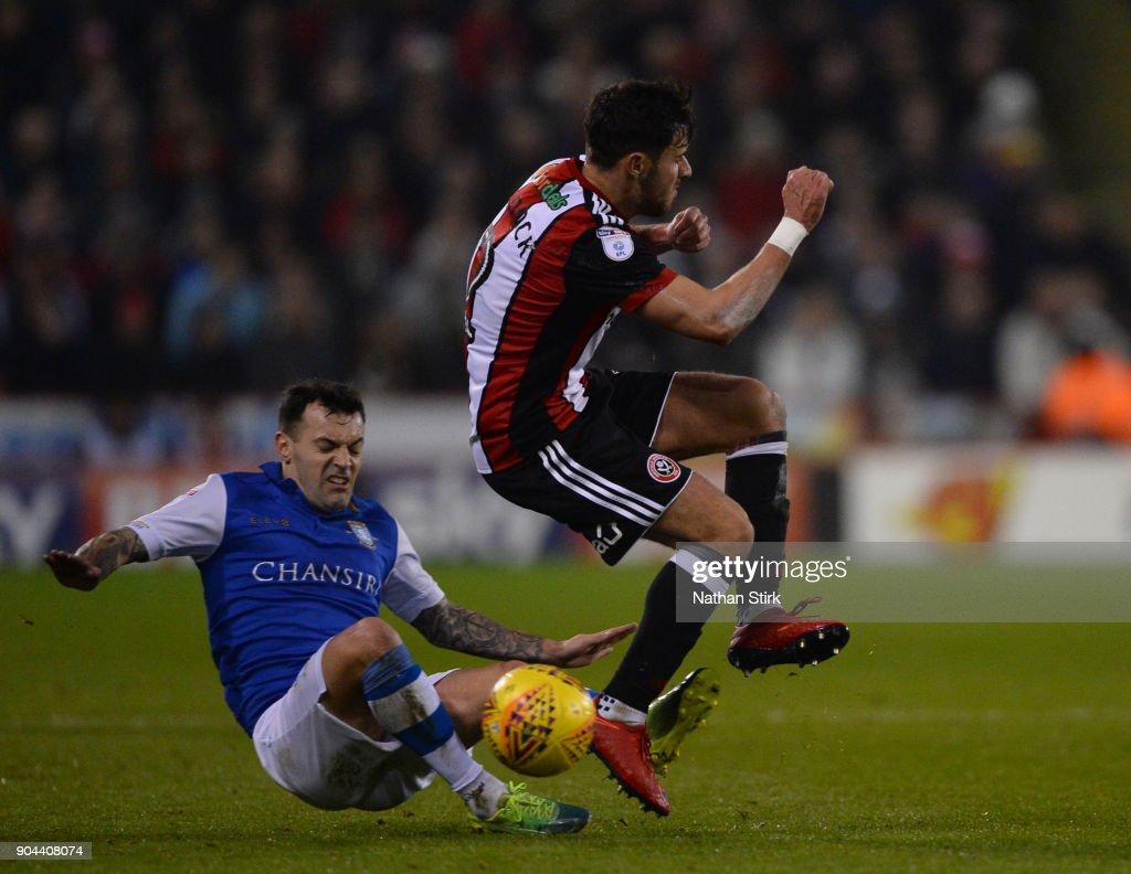 George Baldock of Sheffield United and Ross Wallace of Sheffield Wednesday in action during the Sky Bet Championship match between Sheffield United and Sheffield Wednesday at Bramall Lane on January 12, 2018 in Sheffield, England.