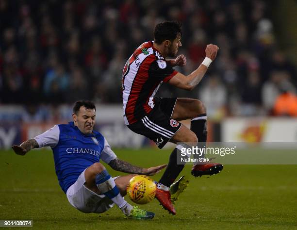 George Baldock of Sheffield United and Ross Wallace of Sheffield Wednesday in action during the Sky Bet Championship match between Sheffield United...