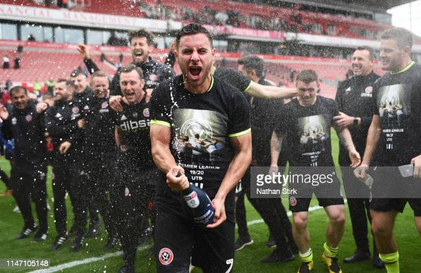 George Baldock of Sheffield United and teammates celebrate their promotion after the Sky Bet Championship match between Stoke City and Sheffield...