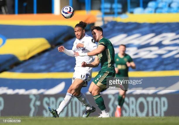 George Baldock of Sheffield United battles for possession with Tyler Roberts of Leeds United during the Premier League match between Leeds United and...