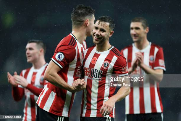 George Baldock of Sheffield United celebrates with teammates following the Premier League match between Tottenham Hotspur and Sheffield United at...