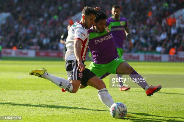 George Baldock of Sheffield United crosses the ball into the box as Jay DaSilva of Bristol City attempts to block during the Sky Bet Championship...
