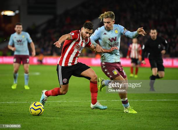 George Baldock of Sheffield United holds off a challenge from Jack Grealish of Aston Villa during the Premier League match between Sheffield United...