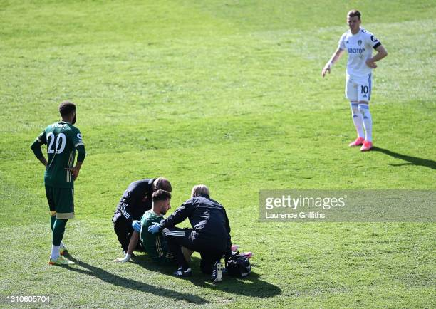 George Baldock of Sheffield United is helped up after receiving medical treatment during the Premier League match between Leeds United and Sheffield...