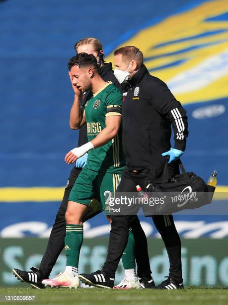 George Baldock of Sheffield United leaves the pitch with an injury during the Premier League match between Leeds United and Sheffield United at...