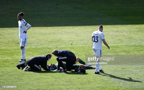 George Baldock of Sheffield United receives medical attention during the Premier League match between Leeds United and Sheffield United at Elland...