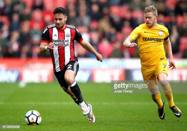 George Baldock of Sheffield United runs with the ball under pressure from Daryl Horgan of Preston North End during The Emirates FA Cup Fourth Round...