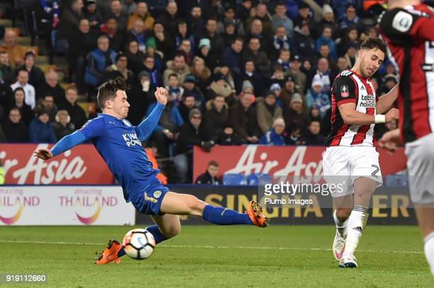 George Baldock of Sheffield United sees his shot saved by Kasper Schmeichel of Leicester City during the FA Cup Fifth round match between Leicester...