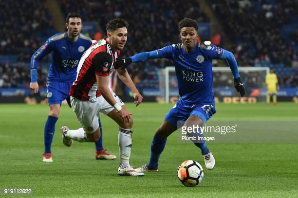 George Baldock of Sheffield United tries to go past Demarai Gray of Leicester City during the FA Cup Fifth round match between Leicester City and...