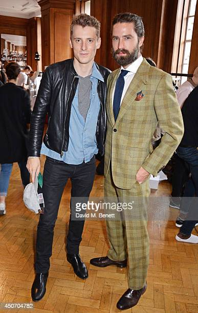 George Barnett and Jack Guinness attend the Jimmy Choo Men's Show Spring Summer 2015 during London Collections Men on June 16 2014 in London England