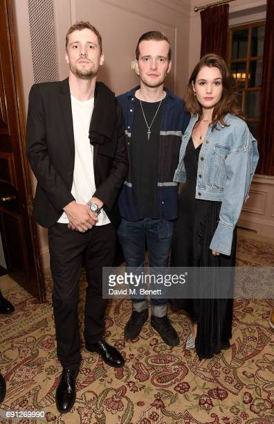 George Barnett Sam Doyle and Sai Bennet attend a Fine Tailoring Dinner hosted by Charlie CaselyHayford and Topman at The Ned on June 1 2017 in London...