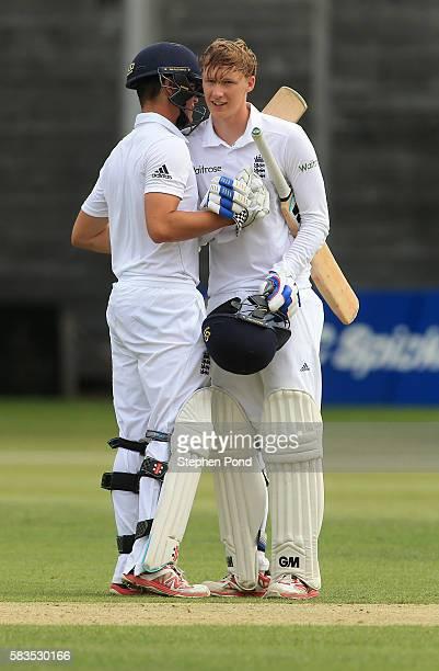 George Bartlett of England celebrates reaching his century of runs with Oli Westbury during the match between England U19's and Sri Lanka U19's at...