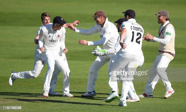 George Bartlett of Somerset celebrates running out Tim Ambrose with his teammates during Day Two of the Specsavers County Championship match between...