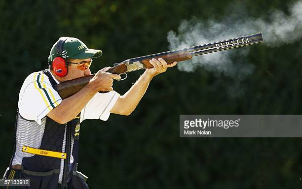 George Barton of Australia shoots during the Mens Skeet Pairs clay target shooting at the Melbourne Gun Club during day five of the Melbourne 2006...