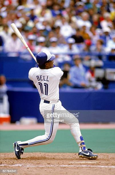 George Bell of the Toronto Blue Jays swings at a pitch during a 1989 game at Skydome in Toronto Ontario Canada