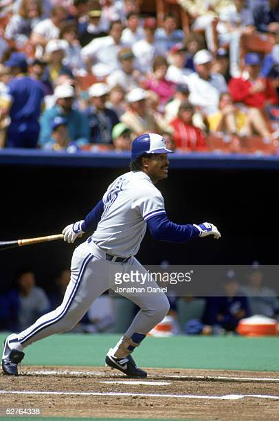 George Bell of the Toronto Blue Jays swings at a pitch during a 1990 game against the Kansas City Royals at Royals Stadium in Kansas City Missouri