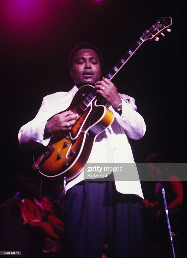 George Benson performs on stage in 1994.