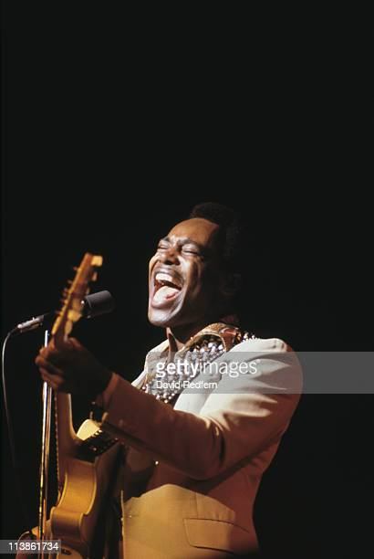 George Benson US singersongwriter and musician playing a guitar while singing into a microphone during a live concert performance circa 1980