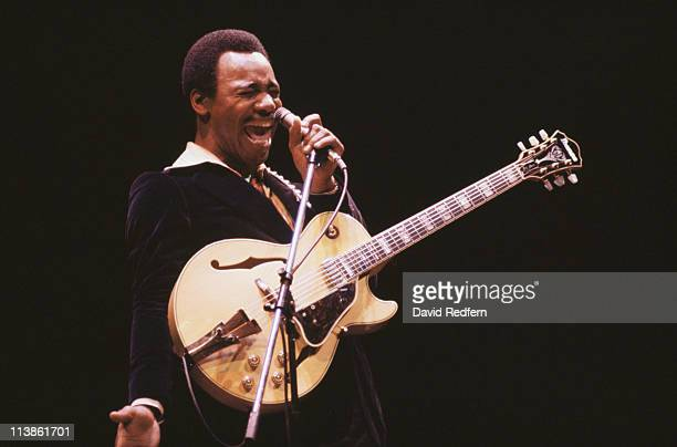 George Benson US singersongwriter and musician singing into a microphone during a live concert performance circa 1980 Benson also has a guitar...
