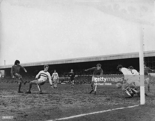George Best about to score his third goal for Manchester United during their Fifth Round FA Cup match against Fourth Division Northampton Town United...