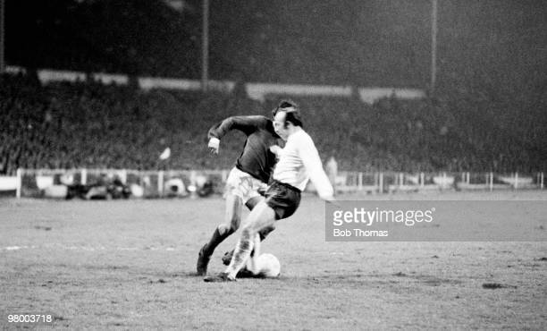 George Best moves past England defender Nobby Stiles to score for Northern Ireland during the British Home International Championship match between...
