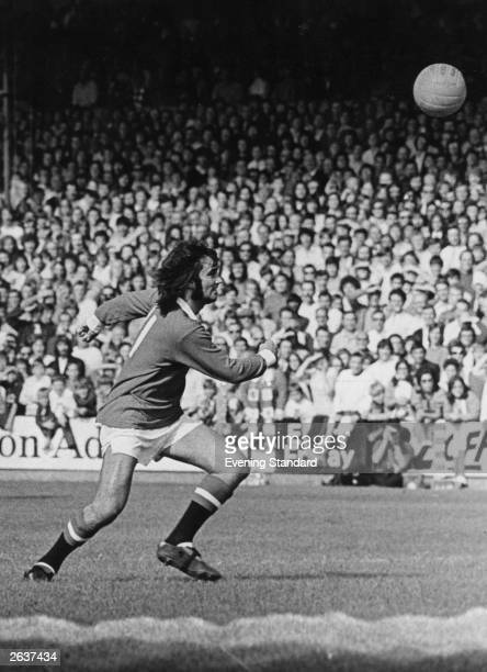 George Best of Manchester United chases the ball