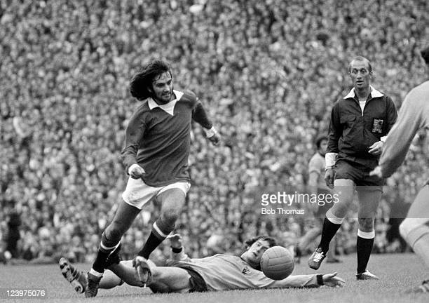 George Best of Manchester United evades a tackle from Wolverhampton Wanderers' Kenny Hibbitt during their First Division match at Molineux in...
