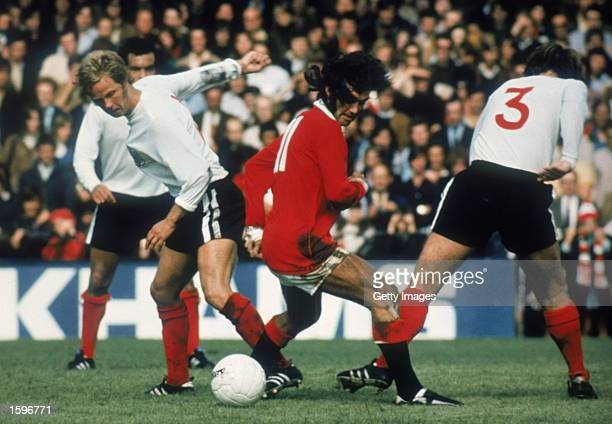 George Best of Manchester United finds no way past the Fulham defence during a Pre-Season Friendly match between Fulham and Manchester United held on...