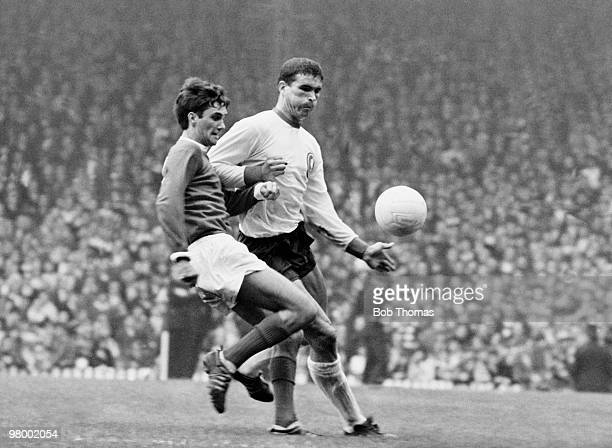 George Best of Manchester United is challenged by Liverpool defender Ron Yeats during their Division One league match at Old Trafford Manchester...