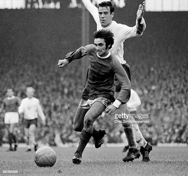 George Best of Manchester United moves past Tottenham Hotspur defender Mike England during the First Division match at Old Trafford in Manchester...