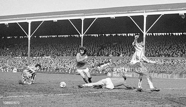 George Best of Manchester United scores past Stoke City goalkeeper Gordon Banks during their Division One match played at the Victoria Ground...