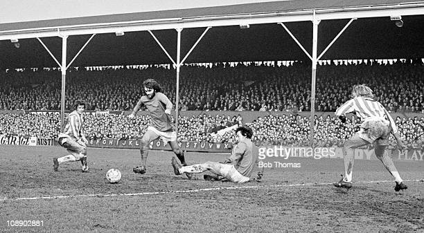 George Best of Manchester United scores past Stoke City goalkeeper Gordon Banks during their Division One match played at the Victoria Ground,...