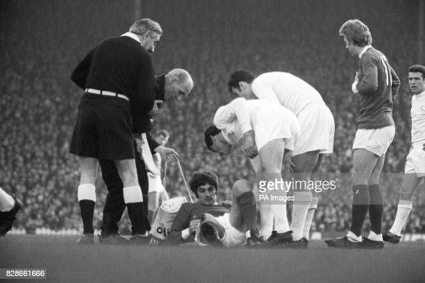 George Best receives treatment during Manchester United's European Cup games against Real Madrid at Old Trafford