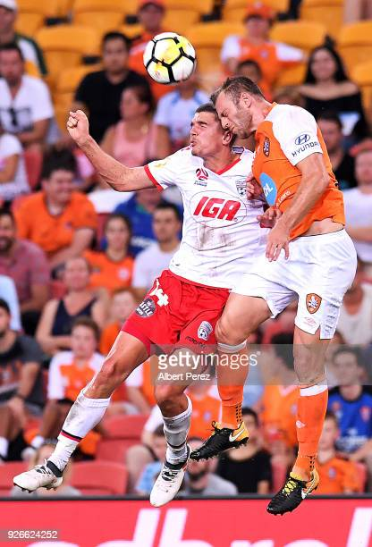 George Blackwood of Adelaide and Avraam Papadopoulos of the Roar compete for the ball during the round 22 ALeague match between the Brisbane Roar and...