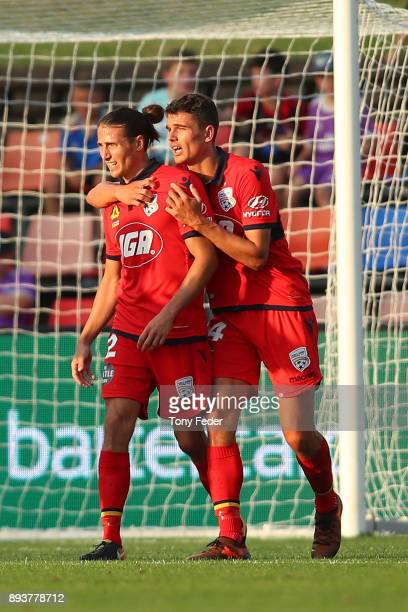 George Blackwood of Adelaide celebrates a goal with a team mate during the round 11 ALeague match between the Newcastle Jets and the Adelaide United...