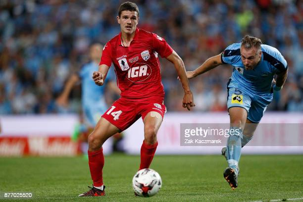 George Blackwood of Adelaide controls the ball to evade Jordy Buijs of Sydney during the FFA Cup Final match between Sydney FC and Adelaide United at...