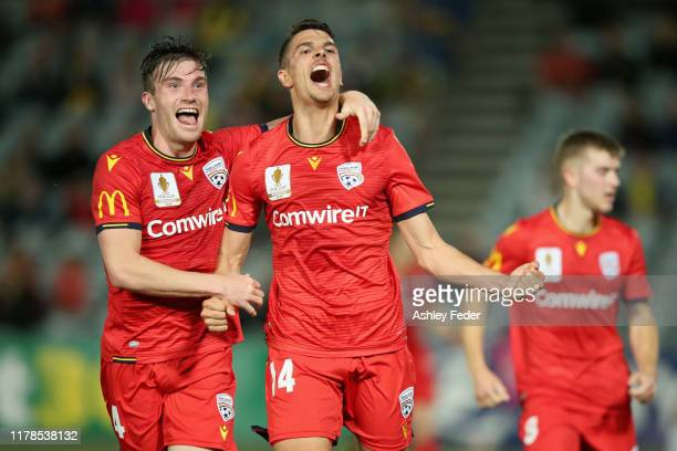 George Blackwood of Adelaide United celebrates his goal with Ryan Strain of Adelaide United during the FFA Cup 2019 Semi Final between the Central...