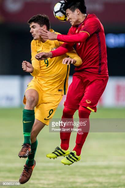 George Blackwood of Australia fights for the ball with Bui Tien Dung II of Vietnam during the AFC U23 Championship China 2018 Group D match between...