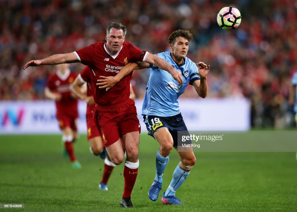 George Blackwood of Sydney FC is challenged by Jamie Carragher of Liverpool during the International Friendly match between Sydney FC and Liverpool FC at ANZ Stadium on May 24, 2017 in Sydney, Australia.