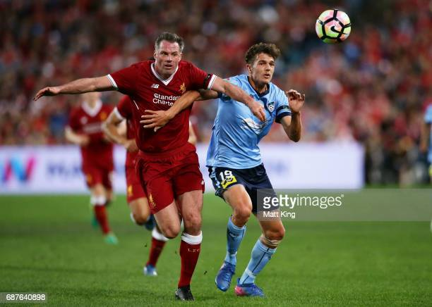 George Blackwood of Sydney FC is challenged by Jamie Carragher of Liverpool during the International Friendly match between Sydney FC and Liverpool...