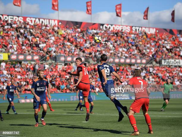 George Blackwood of United and Jack Hingert of the Roar compete for the ball during the round 13 ALeague match between Adelaide United and Brisbane...