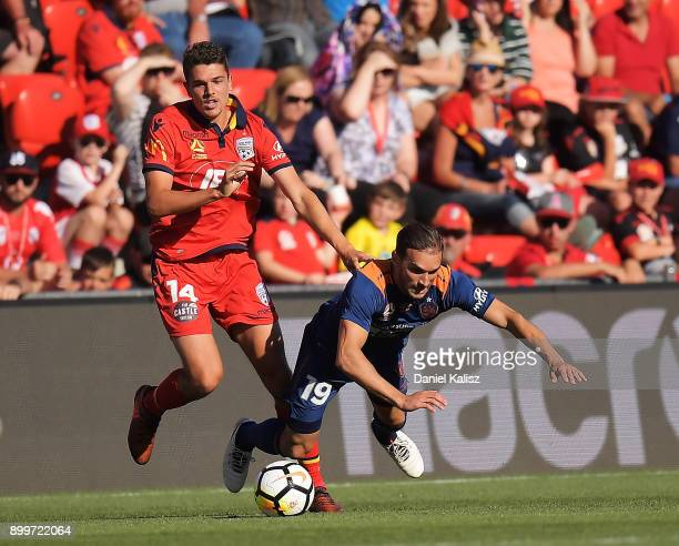 George Blackwood of United competes for the ball with Jack Hingert of the Roar during the round 13 ALeague match between Adelaide United and Brisbane...