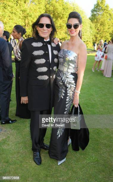 George Blodwell and Christina Estrada attend the Argento Ball for the Elton John AIDS Foundation in association with BVLGARI Bob and Tamar Manoukian...
